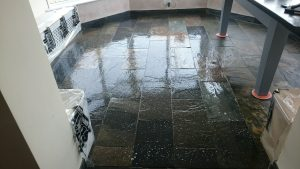 Slate Floor Cleaning In Bristol where the floor has been pre-sprayed